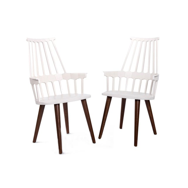 """White Comback Chair(s) by Kartell Comback is a chair featuring a backrest consisting of seven """"teeth"""" which spread out..."""