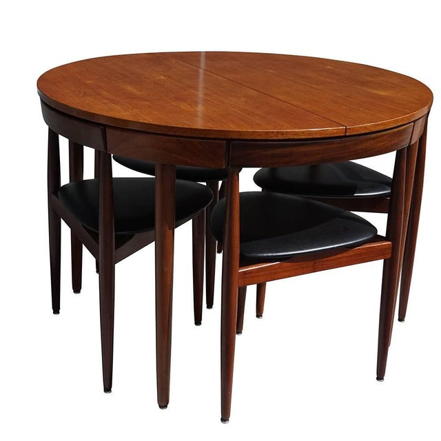 Danish dining set by Hans Olsen with four chairs which fully slide under the round table with only the backrests showing...