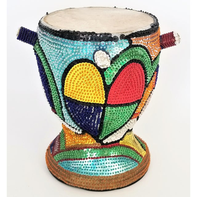 Offering a vintage Haitian Vodoo (Vodou) Beaded Sequined drum, circa 1960s-70s. This hand-made ceremonial/decorative drum...