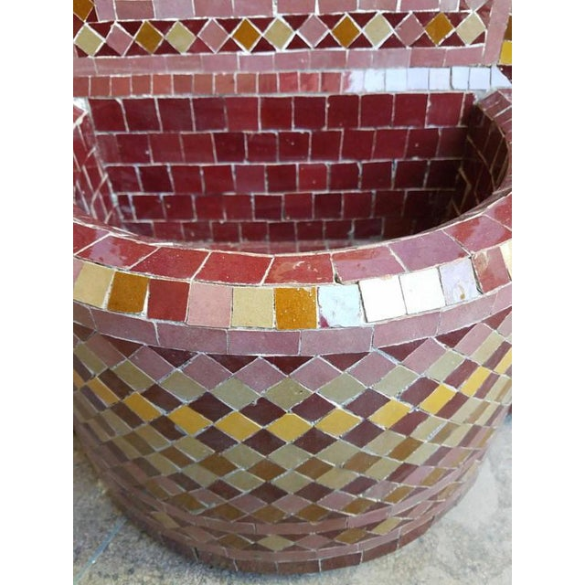 Multicolored tile fountain with red and yellow trim mosaic fountain handmade in Marrakech, Morocco. This beautiful...