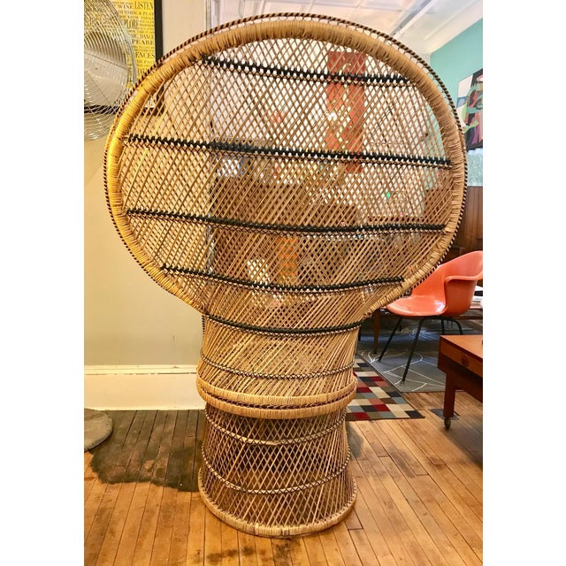 Mid Mod 1960's-70's Wicker Peacock Chair. Decorative aspects around fanned back and arms. In excellent condition with no...