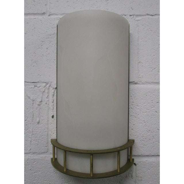 Pair of large, Italian, bronze sconces. Shades are of a hard plastic material.