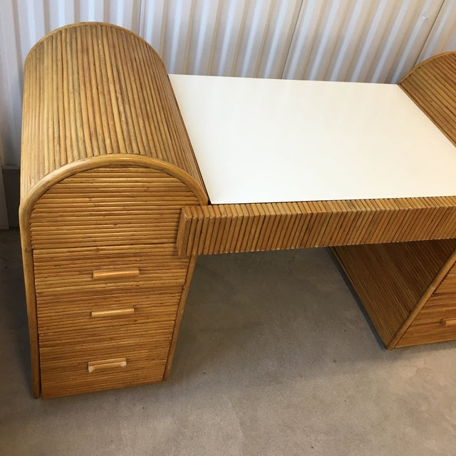Stunning 1980s split reed (pencil reed) bamboo desk with a white laminate top. Some wear and tear due to age and history...