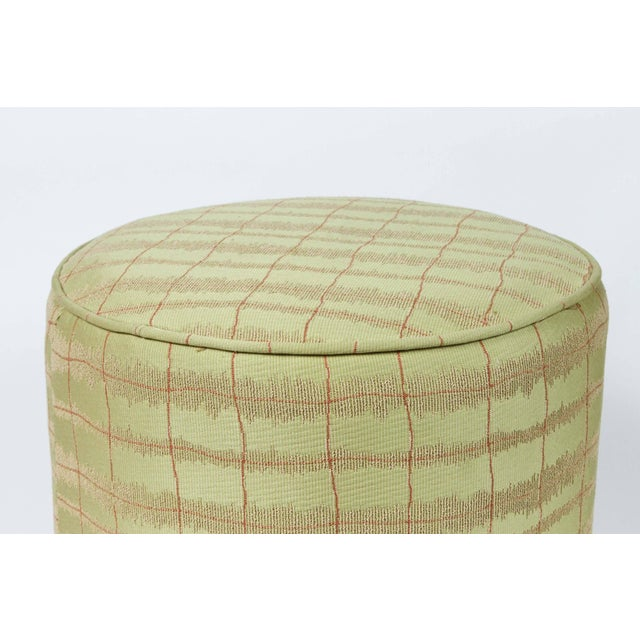 Pair of modern green and gold Moroccan style stools. Use it as a foot stool, pouf, extra seat or modern ottoman. Light and...