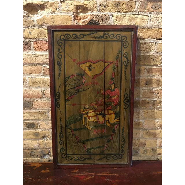 Antique painted wood panel featuring a warrior scene.