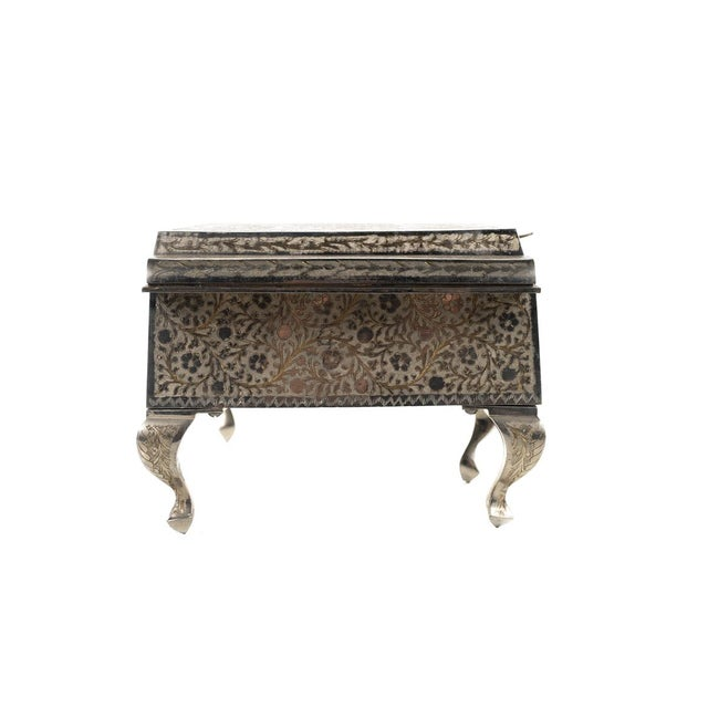 American Swiss music box silver plated Grand piano by Zimbalist. A grand piano with ornately engraved case of silver-...