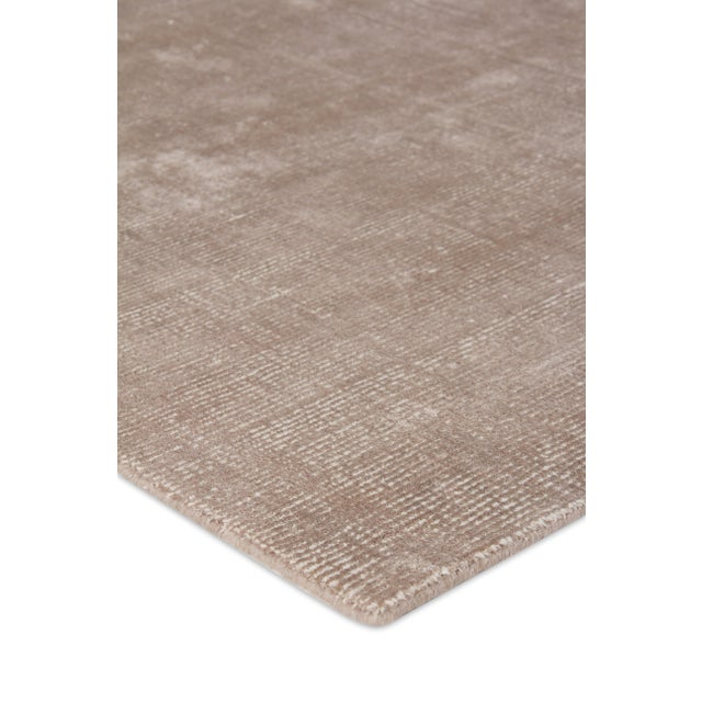 An easy addition to any decor, the Raven rug offers a neutral palette and a luxurious blend of wool and bamboo silk....