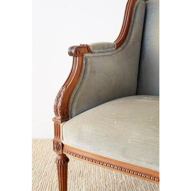 Early 20th Century Pair of French Louis XVI Style Walnut Bergère a Oreilles For Sale - Image 5 of 13