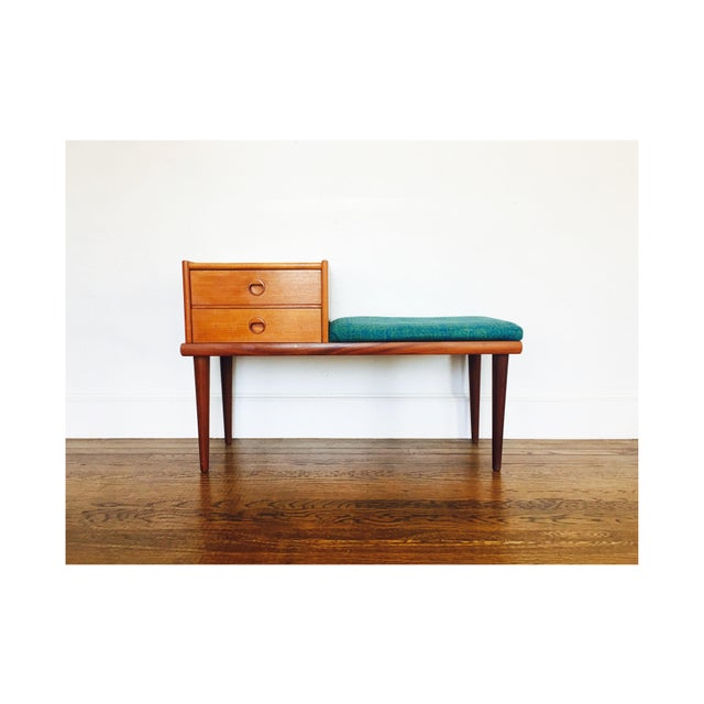 A wonderful mid century teak telephone bench made by Ganddal Mobelfabrikk in Norway. Designed in classic mid century lines...