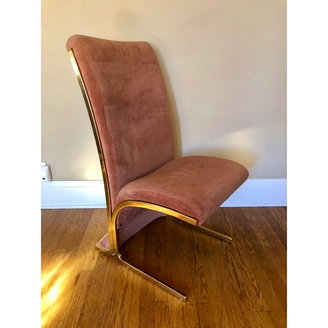 Set of six 1970's modern brass cantilever dining chairs in the style of Milo Baughman. Original salmon/peach upholstery.