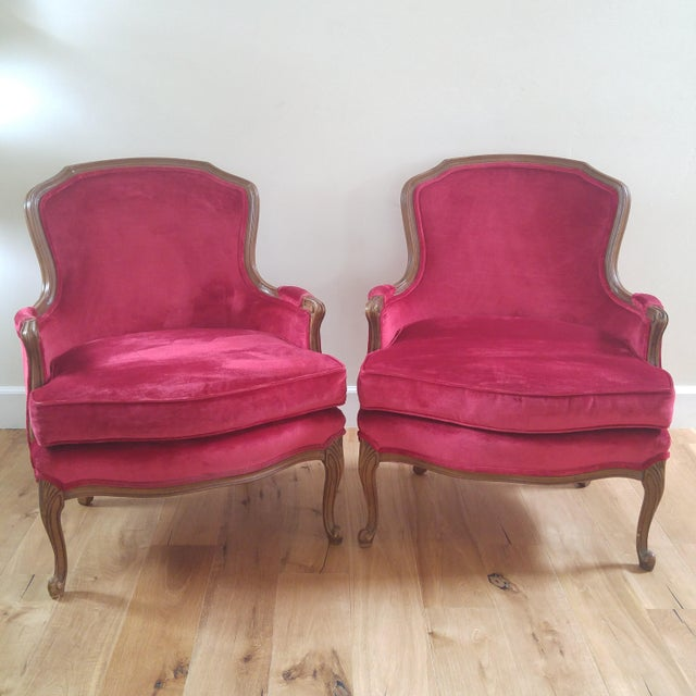 The color of these chairs is stunning! Beautiful raspberry red color. The fabric on both chairs is in good condition....