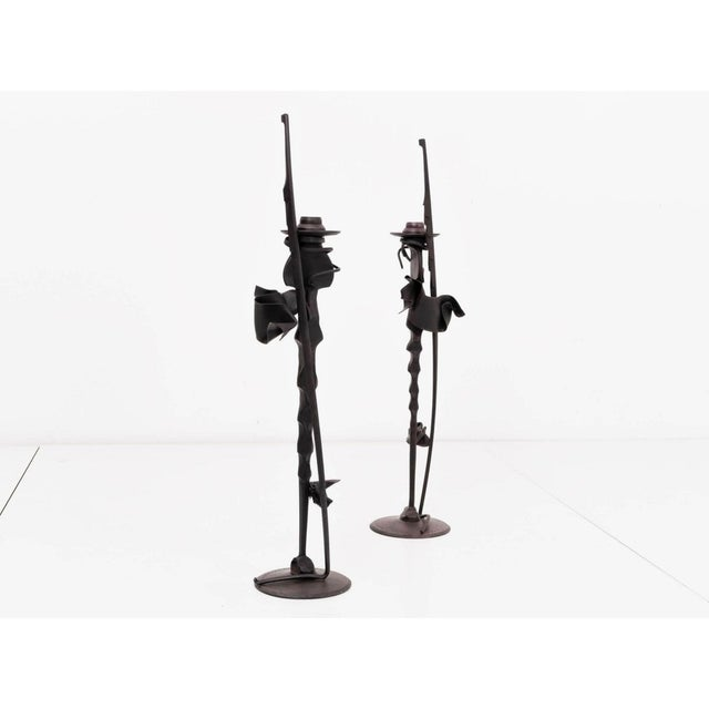 A pair of tall candlesticks by Albert Paley. Forged and blackened steel. Signed and dated [Albert Paley 1992].