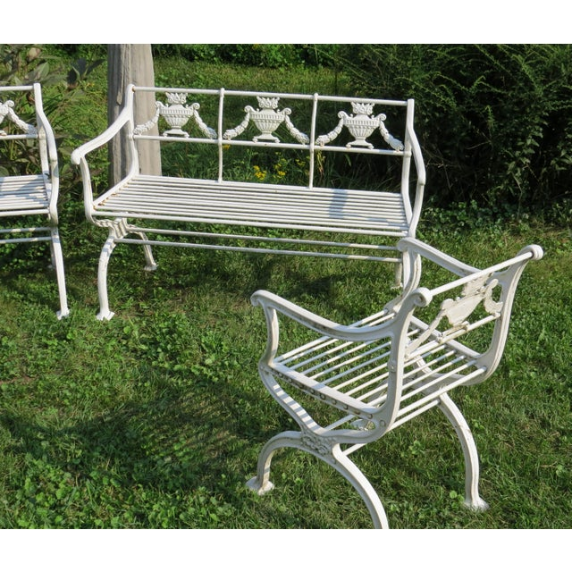 Spectacular turn-of-the-century 'neoclassical' cast iron suite consisting of 2 benches and 2 armchairs. Each piece with...