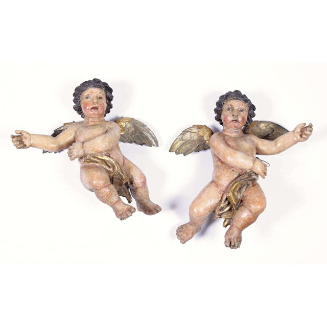 Exceptional pair of antique hand-carved and hand painted cherubs from Italy, circa 1720, with original polychrome finish...