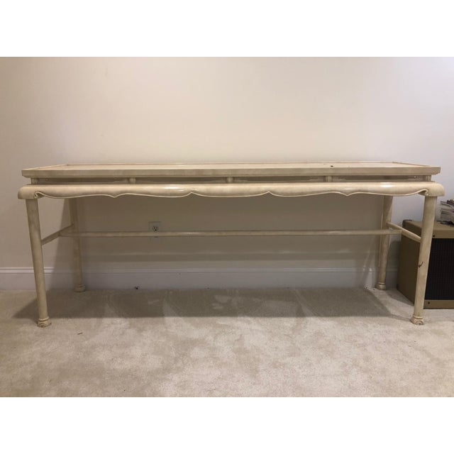 This is a beautiful very solidly constructed lacquered sofa table in a Chinoiserie style. The finish was scuffed in a few...