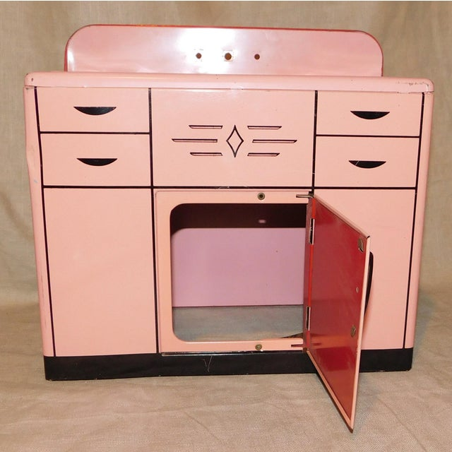 Sweet Wolverine toy sink in a fun retro pink color. So cute in a vintage toy display!