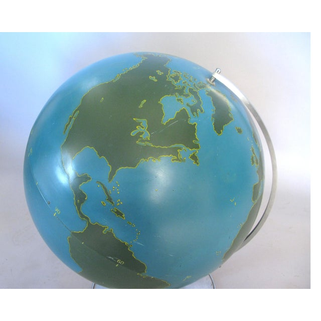 A wonderful antique 1940s aviator globe made by A.J. Nystrom. These were designed to write on with chalk to depict...
