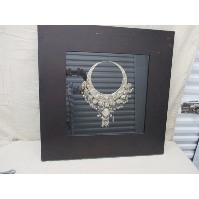 Reproduction of Museum Piece of Silver Medal Necklace Displayed in a shadow box Formica black frame 21st Century, China...
