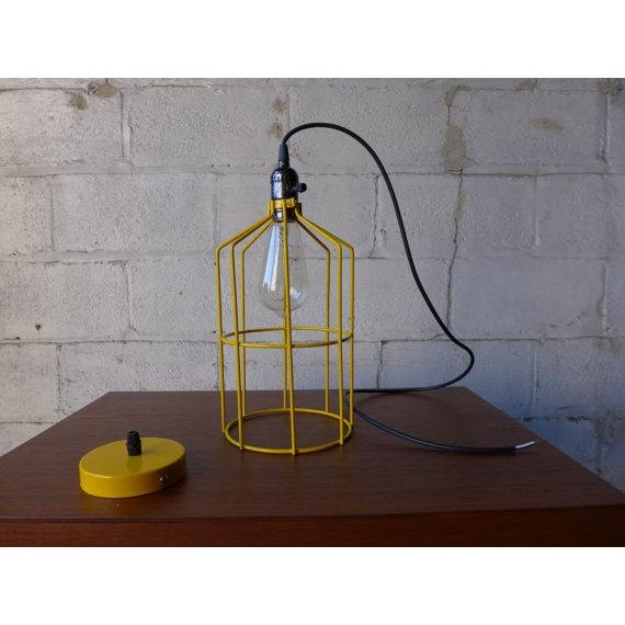 """Mid century styled canary yellow cage pendant lamp in lovely canary yellow. Dimensions: 6.25"""" diameter 11.5"""" high 43""""..."""