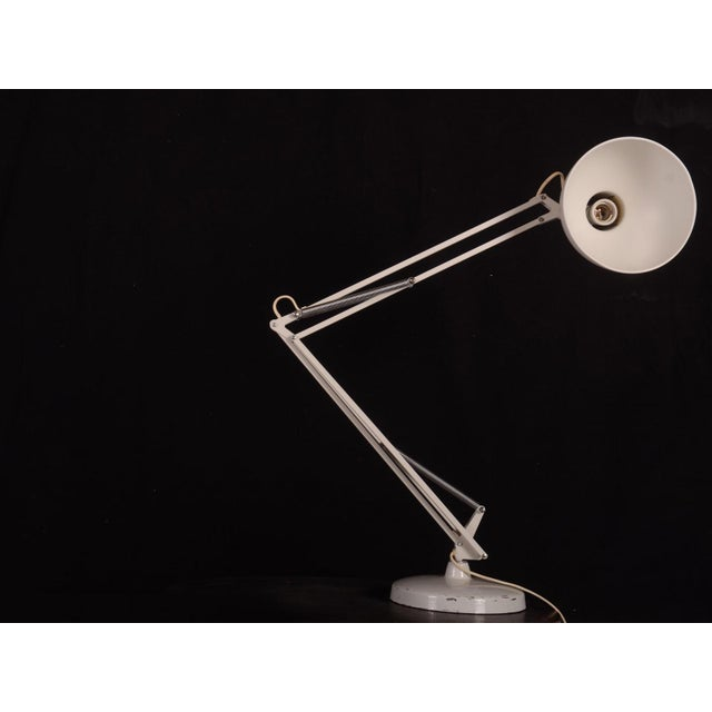 This white lacquered steel table lamp was designed by Louis Poulsen, Denmark in the 1970s.