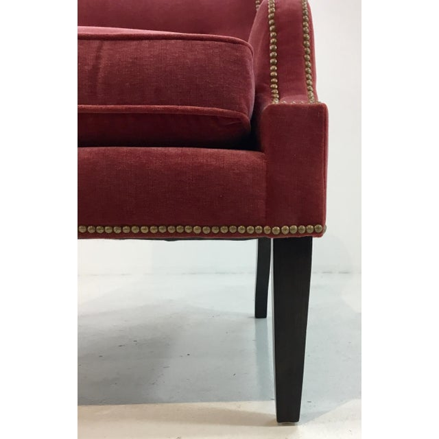 Stylish modern Thomasville Red Velvet Chandon Club Chair, black legs and antique brass nailhead detail, showroom floor...