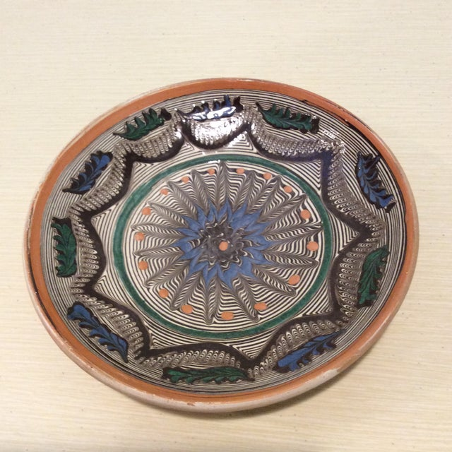Beautiful Romanian pottery bowl. Can be used as a bowl or as wall art. Beautiful mandala design. 7 inches in Diameter; 1.5...