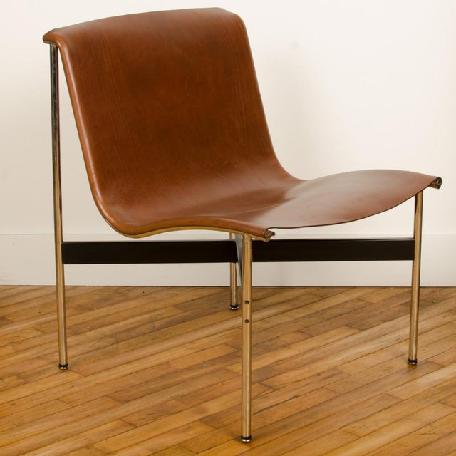 A Mid-Century designed chair, tan leather with medium antique bronze finish, 1952. Designed by Katavolos Littell, and...