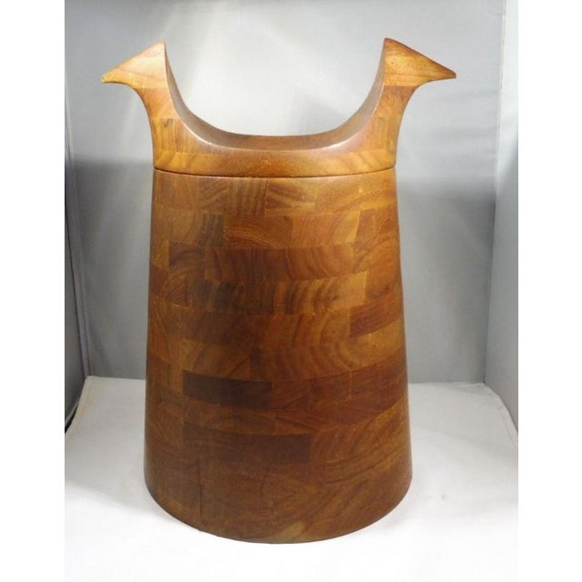 Very unusual mid century modern teak ice bucket with horns sold as found in the vintage condition previously owned...