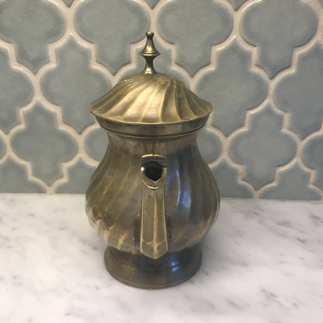 Art Deco Silver Plated tea pot. Hinged lid. Some tarnishing. Brass color.