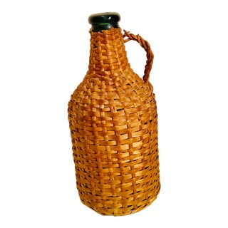1970s Wicker Wrapped Bottle With Handle For Sale