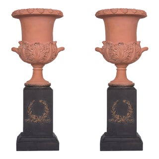 Late 20th Century Neoclassical Terracotta Urns on Decorated Plinths - a Pair For Sale