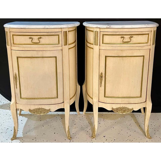 Demi-Lune pair of Hollywood Regency painted end tables, nightstands or pedestals. Each having a d shaped form with a white...