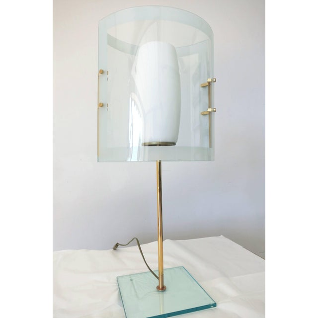 Italian vintage table lamp with bevelled and frosted glass shades mounted on brass hardware, after Fontana Arte, circa...