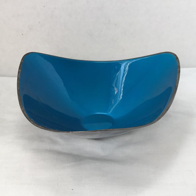 A cool vintage reed and baron silver plate three sided bowl with turquoise blue enamel on the inside. The triangle shaped...
