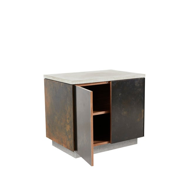 """The """"S.O. Side Table"""" with doors integrates three elemental materials, concrete, steel and wood. The counter-top and base..."""