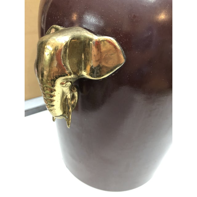 Vintage Morris Greenspan 1970s burgundy enameled with solid brass elephant heads details on both sides, table lamp. Lam is...