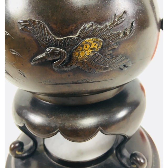 This is a 20th Century Japanese bronze footed bowl. Signed on the underside. The width and depth measurements below are at...