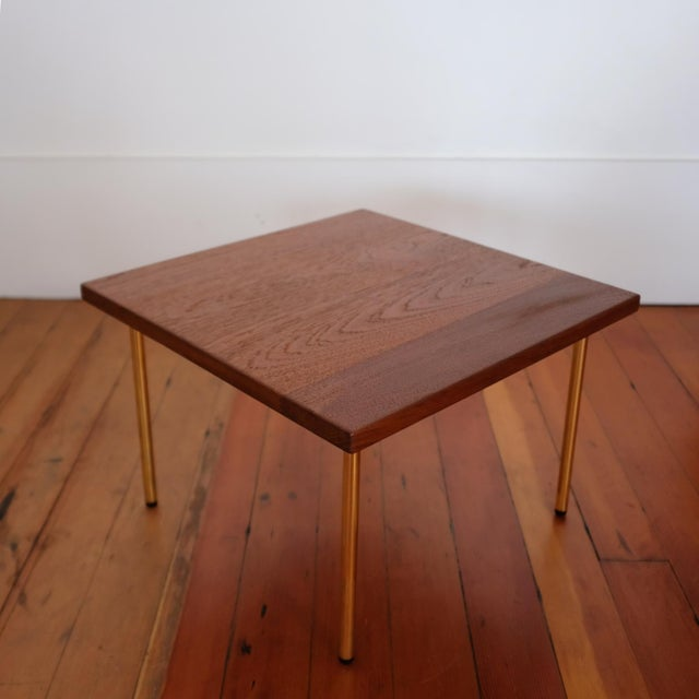 Peter Hvidt and Orla Mølgaard-Nielsen occasional table for John Stuart. Solid teak top with solid brass tubular legs. Nice...