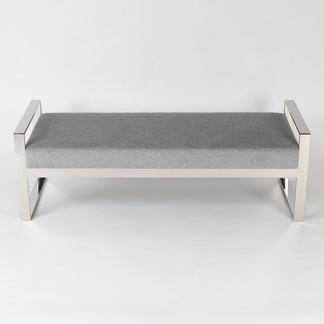 Nicely scaled bench with an open, polished-chrome frame. The comfortable upholstered seat has been recovered in a soft,...