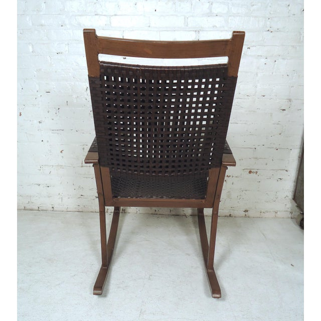 Great vintage modern style rocking chair featuring a sturdy frame, wicker seating and back rest. Please confirm item...