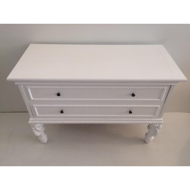 White Hollywood regency two drawer commode with wonderful tassel legs. Newly lacquered.