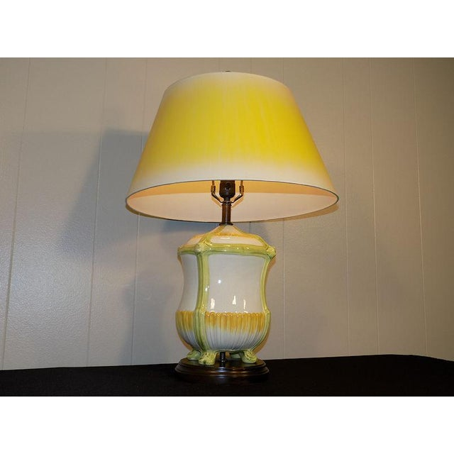Beautiful Frederick Cooper lamp with original shade and hand-decorated, footed pottery base. Fine quality as always from...