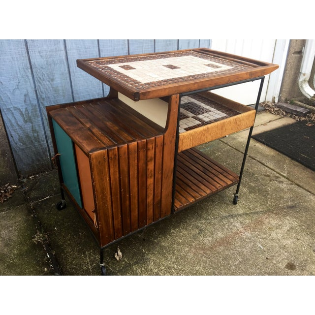This listing is for a mid Century Arthur Umanoff bar cart. Condition-very good vintage condition with signs of wear from...