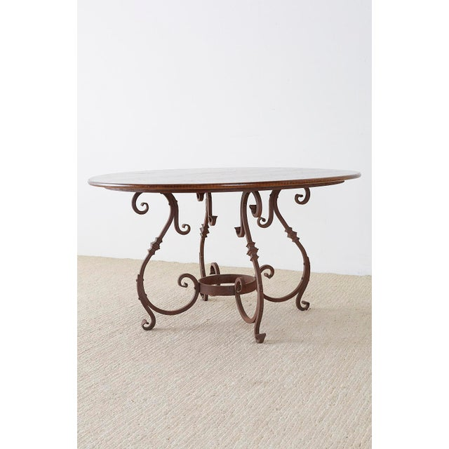 Italian Oak and Scrolled Iron Round Dining Table For Sale - Image 9 of 13