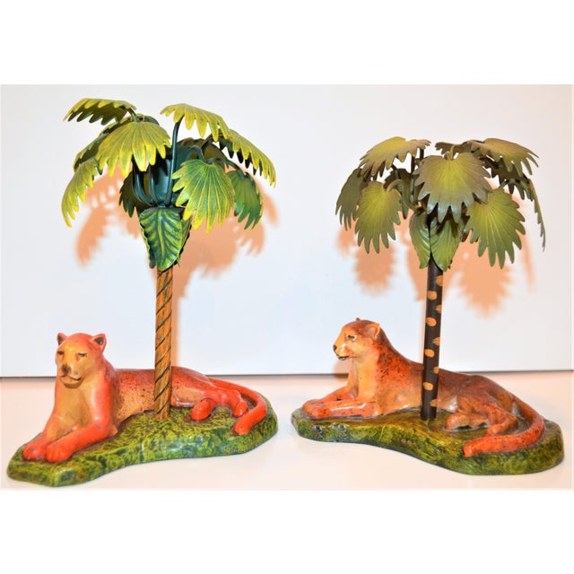 This is a pair of Antique Art Deco Metal Leopard and Palm Tree Candle Holders. They can be used as simply figurines and it...