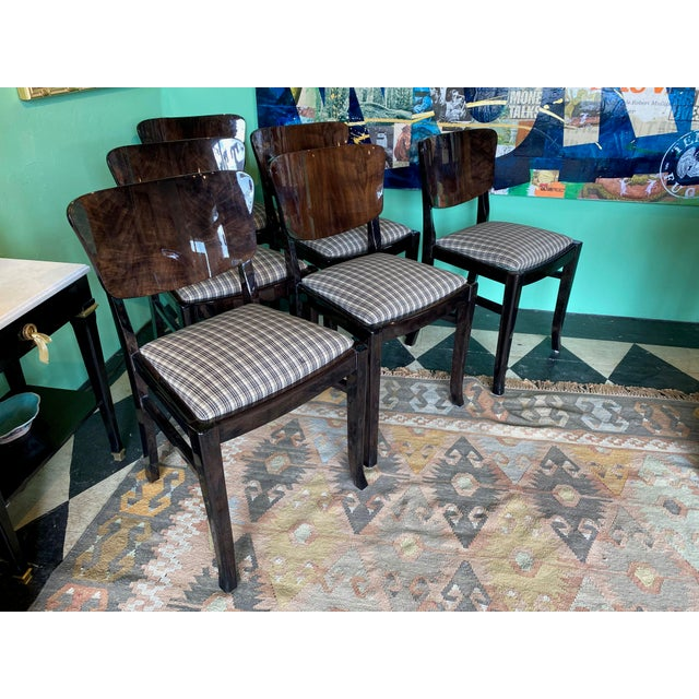 Set of six English 20th century ebonized finish over walnut with new seat padding and upholstery. Drop in seat. Circa...