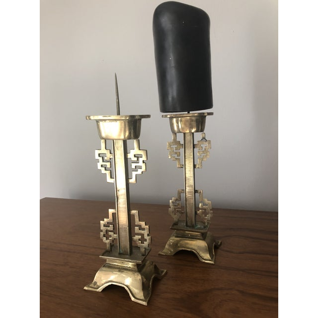 Vintage chic brass chinoiserie candle holders. Holds a chunky pillar candle. Candle not included.