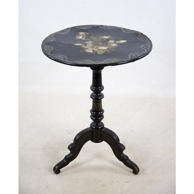 An absolutely breath taking late 19th c. Victorian papier-mâché round mother-of-pearl tilt top table will complete your...