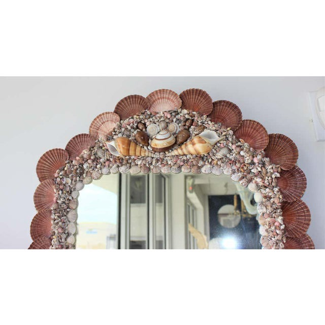 This stylish seashell encrusted mirror was created exclusively for the Iconic Snob Galeries by a local Palm Beach artist....