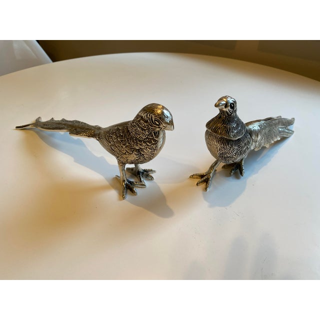 Perfect for a fall tablescape. Bird figurines with long tails.